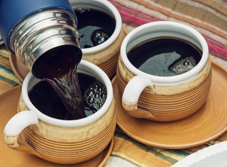 Three beautiful ceramic cups and  with coffee. Detail photo. Stock Photo