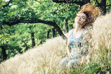 Hurl: Beautiful young woman throws hair in the forest. Beauty and nature. Stock Photo