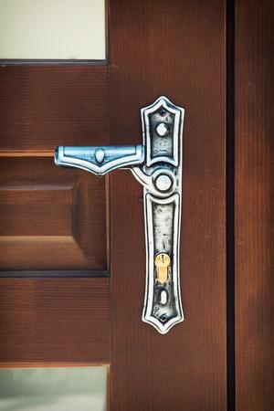door knob: Stylish door knob on the wooden doors.