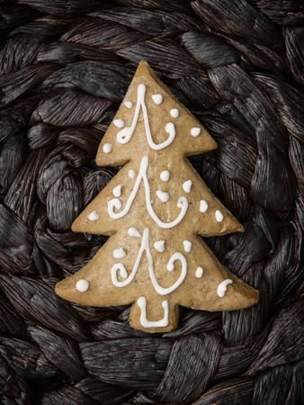 gingerbread cookie: Christmas tree shaped gingerbread cookie. Yuletide. Stock Photo