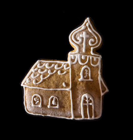 gingerbread cookie: Gingerbread cookie -church on the dark background. Christmas theme.