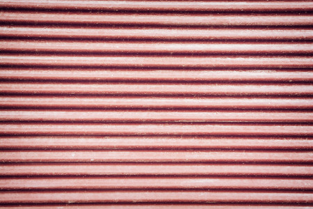 red sheet: Red corrugated metal sheet texture background. Horizontal stripes.