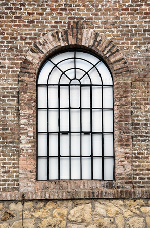 architectural  detail: Old barred window. Architectural detail.