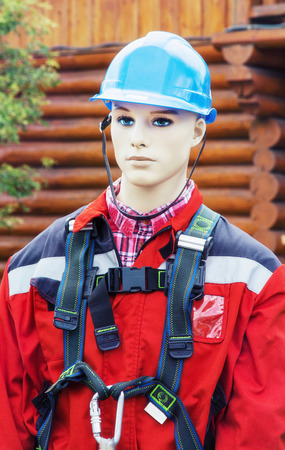 protective suit: Figurine with rescue clothing. Mannequin wearing red protective suit. Stock Photo