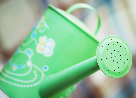 wateringcan: Detail of green metal watering can Stock Photo