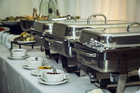 catering food: Catering boxes of stainless steel on wedding tables.