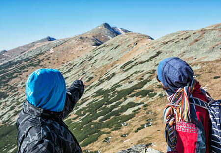 mountainy: Young people on the trip showing at the hill Chopok, Low Tatras, Slovakia. Seasonal tourism. Stock Photo