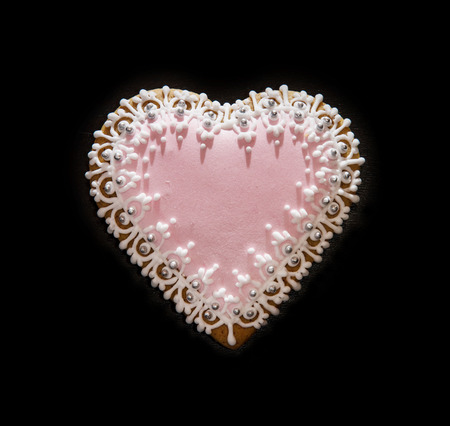 gingerbread heart: Gingerbread heart on the black background. Valentines day. Symbol of lovers.