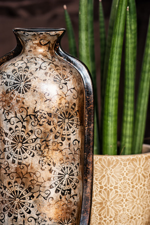 garniture: Ceramic vase with artistic pattern and potted plant. Beauty decorations.
