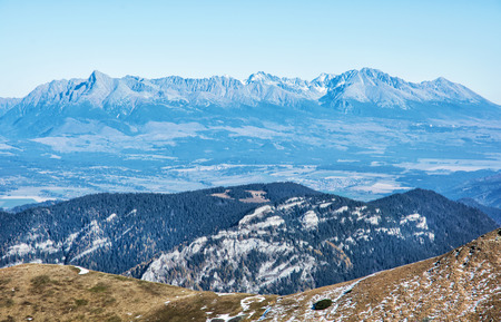 mountainy: View of the High Tatras from the Low Tatras. Travelling theme. Natural seasonal scene. Mountains ponorama.