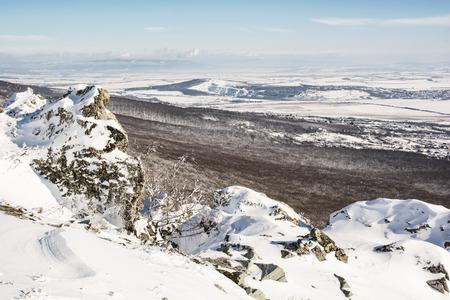 slovak: Snowy rocks, forest and fields. Seasonal landscape. Slovak republic.
