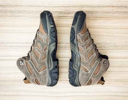outsole: New teenage outdoor shoes on the wooden background. Beauty and fashion. Stock Photo