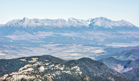 View of the High Tatras from the Low Tatras. Natural seasonal scene. Mountains ponorama. Mountain peaks.