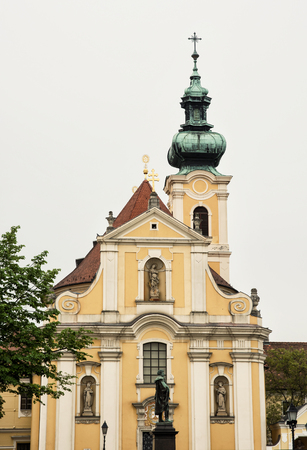 vertical composition: Carmelite church in Gyor, Hungary, central Europe. Vertical composition. Cultural heritage. Stock Photo
