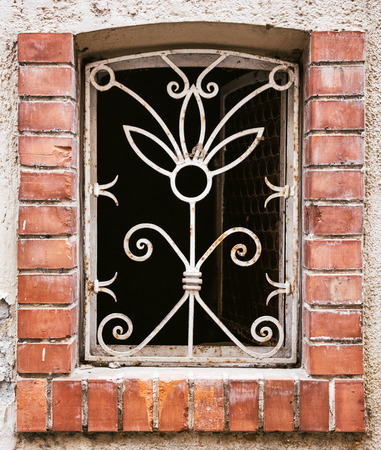 barred: Old barred window on the wall. Architectural elements. Stock Photo