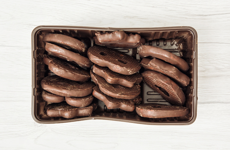 confection: Tasty chocolate cookies in the box. Confection theme.