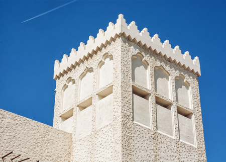 arabic architecture: Building in the arabic architecture design and flying airplane. Travel destination.