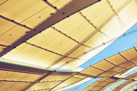 architectural lighting design: Futuristic roof on the exhibition. Outdoor space. Stock Photo