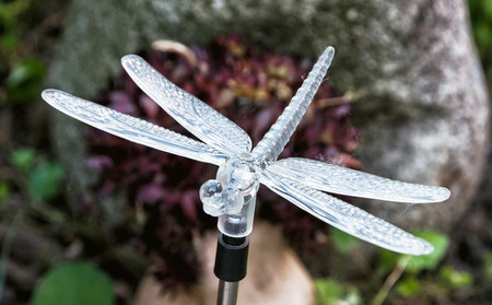 symbolic: Decorative dragonfly in the garden. Symbolic object. Stock Photo