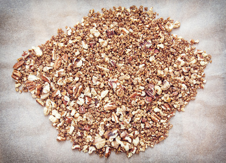 pecans: Background of cracked pecans and walnuts with caramelized brown sugar. Food theme. Healthy lifestyle.