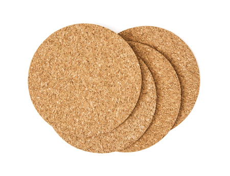 corked: Cork drink coasters arranged on the white background.