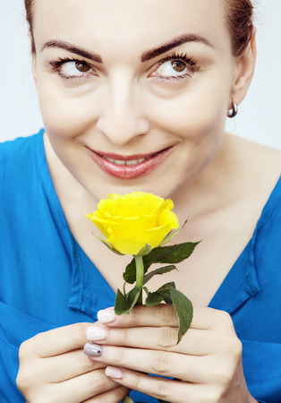 sniff: Young lovely caucasian woman sniff yellow rose. Beauty and fashion.