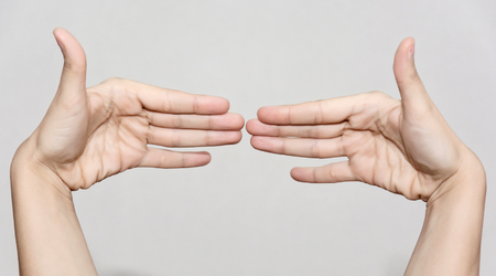 body and part: Female hands making funny shape. Body part.