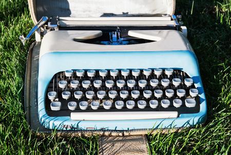 typewriter: Old retro typewriter on the grass. Journalism.