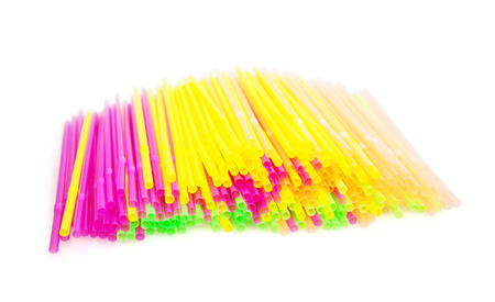 rainbow cocktail: Plastic colorful drinking straws on the white background. Party theme. Stock Photo