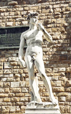 artistic nude: Michelangelos David statue in front of the Palazzo Vecchio (Old Palace), Florence, Tuscany, Italy. Cultural heritage. Editorial