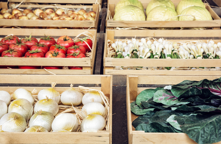 greengrocery: Various vegetable in wooden containers. Rural marketplace. Healthy food. Stock Photo
