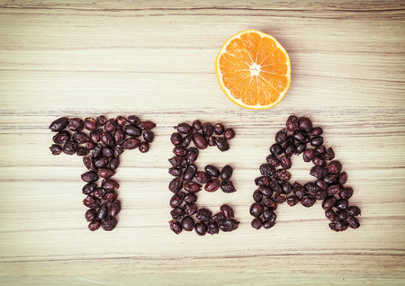 sliced orange: Title TEA composited of the dried rosehips with sliced orange. Healthy food. Stock Photo