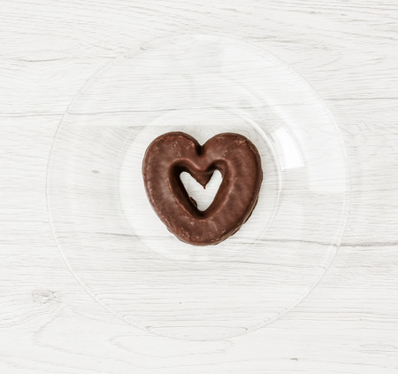 gingerbread cookie: Heart shaped gingerbread cookie. Symbol of love. Sweet food theme.