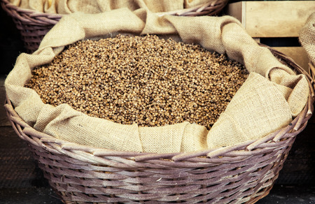 white pepper: White pepper in the wicker basket. Shop with spices.