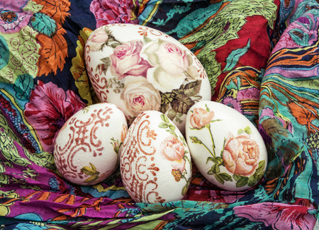 easteregg: Handmade Easter eggs and colorful scarf. Holiday symbol. Artistic objects.