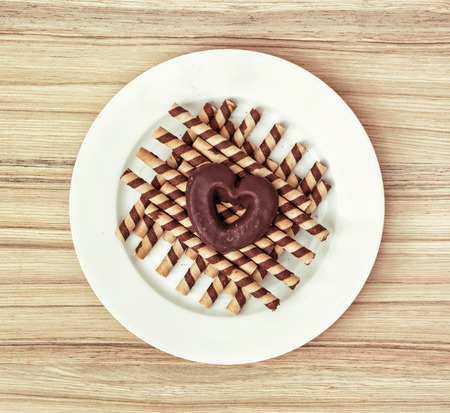 chocolaty: Chocolate rolls and heart shaped gingerbread cookie. Sweet love. Valentines Day.