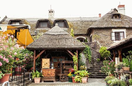 tourist destination: Garden restaurant with thatch in hungarian village, Hungary. Tourist destination.