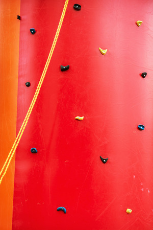 fusing: Red climbing wall. Leisure activity. Sport theme.