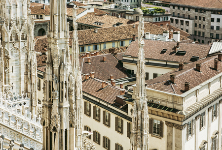 religious art: View of the city Milan from the Duomo cathedral, Italy. Travel destination. Religious art.