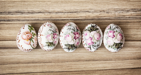 easteregg: Five Easter eggs on the wooden background. Easter holiday. Symbol of springtime.
