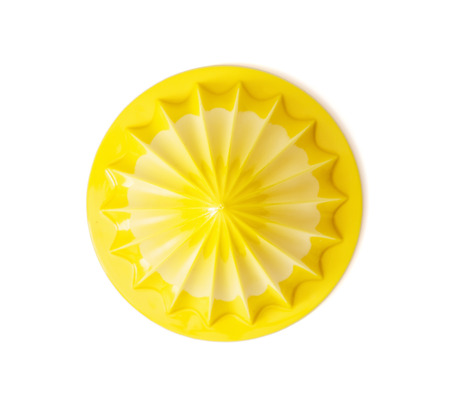 Yellow citrus juicer isolated on the white background. Kitchen equipment.