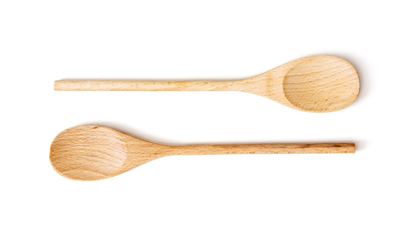 kitchen equipment: Two wooden spoons on the white background. Kitchen equipment. Stock Photo