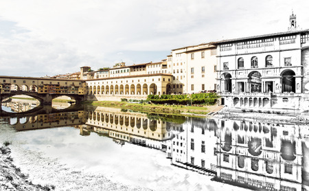 tuscany: From sketch to the Florence city - Beautiful Ponte Vecchio, Vasari Corridor and Uffizi Gallery are mirrored in the river Arno. Tuscany, Italy. Past and present. Travel destination.
