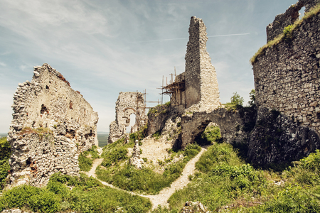 mystic place: Plavecky castle in Slovak republic. Ruins with scaffolding. Travel destination. Cultural heritage Editorial