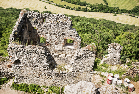 central europe: Ruins of Plavecky castle and old barrels with white color, Slovak republic, central Europe.