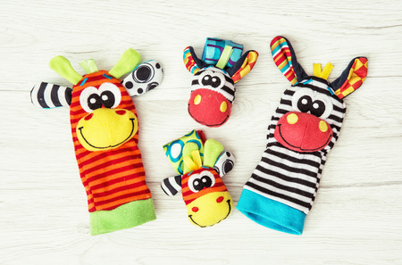 Colorful hand puppets and wrist pals. Funny toys. Vibrant colors. Stock Photo