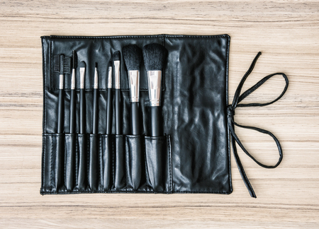 leather bag: Set of cosmetic brushes in black leather bag. Beauty and fashion. Beauty salon.