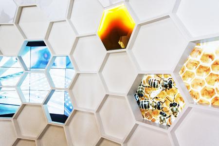 symbolic: White plastic honeycomb on the exhibition. Symbolic decoration.