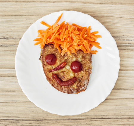 idealism: Funny face made of bread, carrot, chilli, tomatoes and ketchup. Humorous food. Little prince.