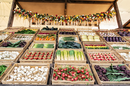 Various vegetables in wooden containers in rural marketplace. Healthy food. Stock Photo
